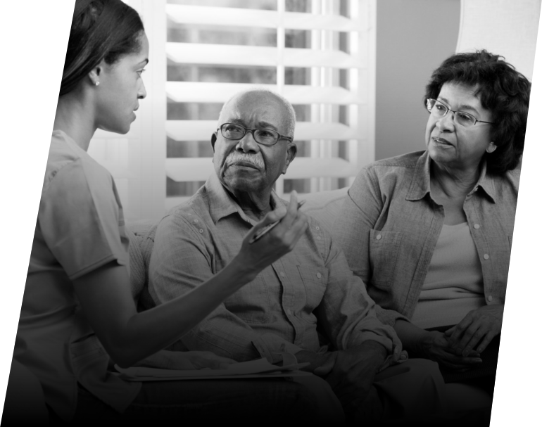caregiver giving consultation advise to elderly couple